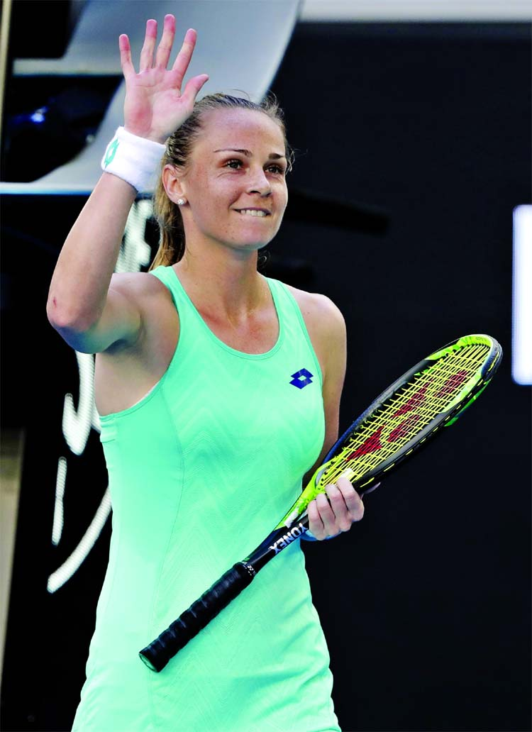 Slovakia's Magdalena Rybarikova waves after defeating Ukraine's Kateryna Bondarenko during their third round match at the Australian Open tennis championships in Melbourne, Australia on Friday.
