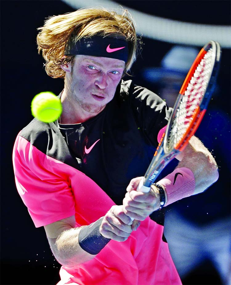 Russia`s Andrey Rublev makes a backhand return during his third round match against Bulgaria's Grigor Dimitrov at the Australian Open tennis championships in Melbourne, Australia on Friday.