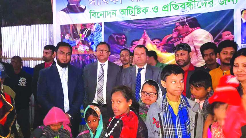 Commerce Secretary Subhasish Basu, passes time with the autistic children at Sarika Fantasy Park of 23rd Dhaka International Trade Fair in the city on Wednesday. Mahbubur Rahman Palash, Managing Director of the park, Bijoy Bhattacharjee, Vice Chairman, Abu Morshed, Secretary and Abdur Rouf, Director of EPB were also present among others. 25 autistic children get free entertainment in the park.