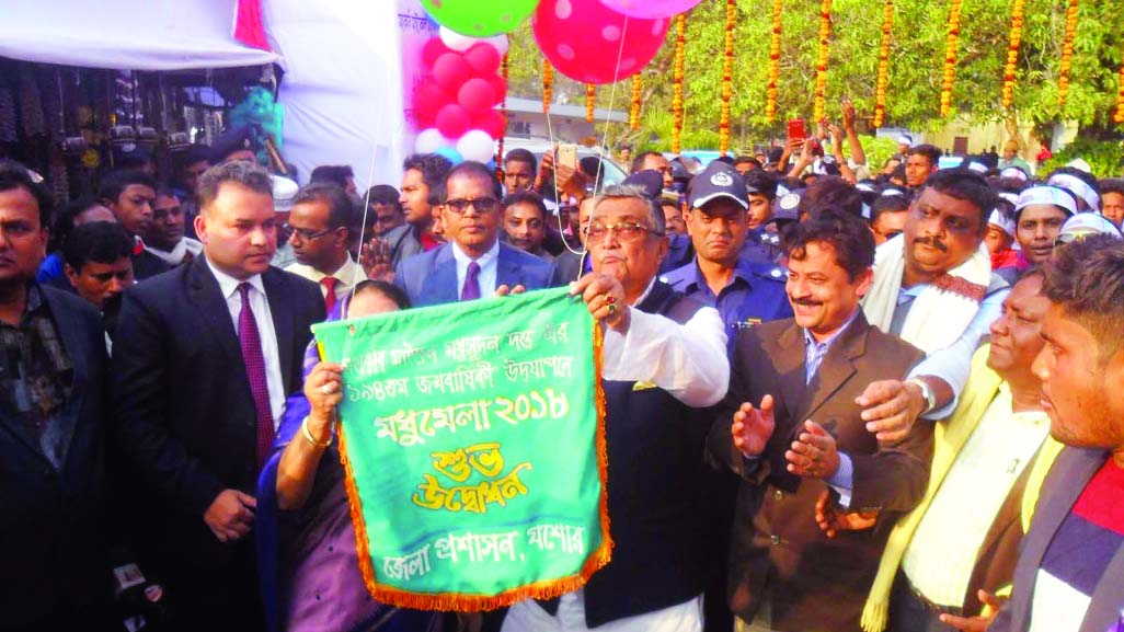 KESHABPUR (Jessore):  Local Government, Rural Development and Co-operatives Minister Khandker Mosharraf Hossain  MP inaugurating  the weeklong 'Madhu Mela    marking  194th birth anniversary of great poet and originator of Bangla sonnets Michael Madhusudan Dutt at Sagordari in Keshabpur Upazila as Chief Guest yesterday.