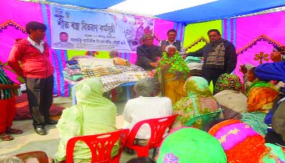 NILPHAMARI: England expatriate Barrister Imran Kabir Chowdhury Johnny  distributing blankets among the cold -hit people at Azizarer Hat in Domar Upazila  yesterday.