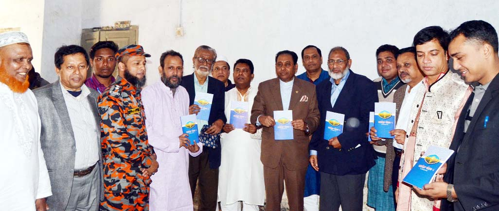 VC of Chittagong  University (CU) Prof Dr Iftakhr Uddin Chowdhury Unveiling Cover of the Book 'Sufisum Seris-02' written by lion Barun Kumar Acharjo  at the hall Room of Nasirabad Boys High School on Friday.
