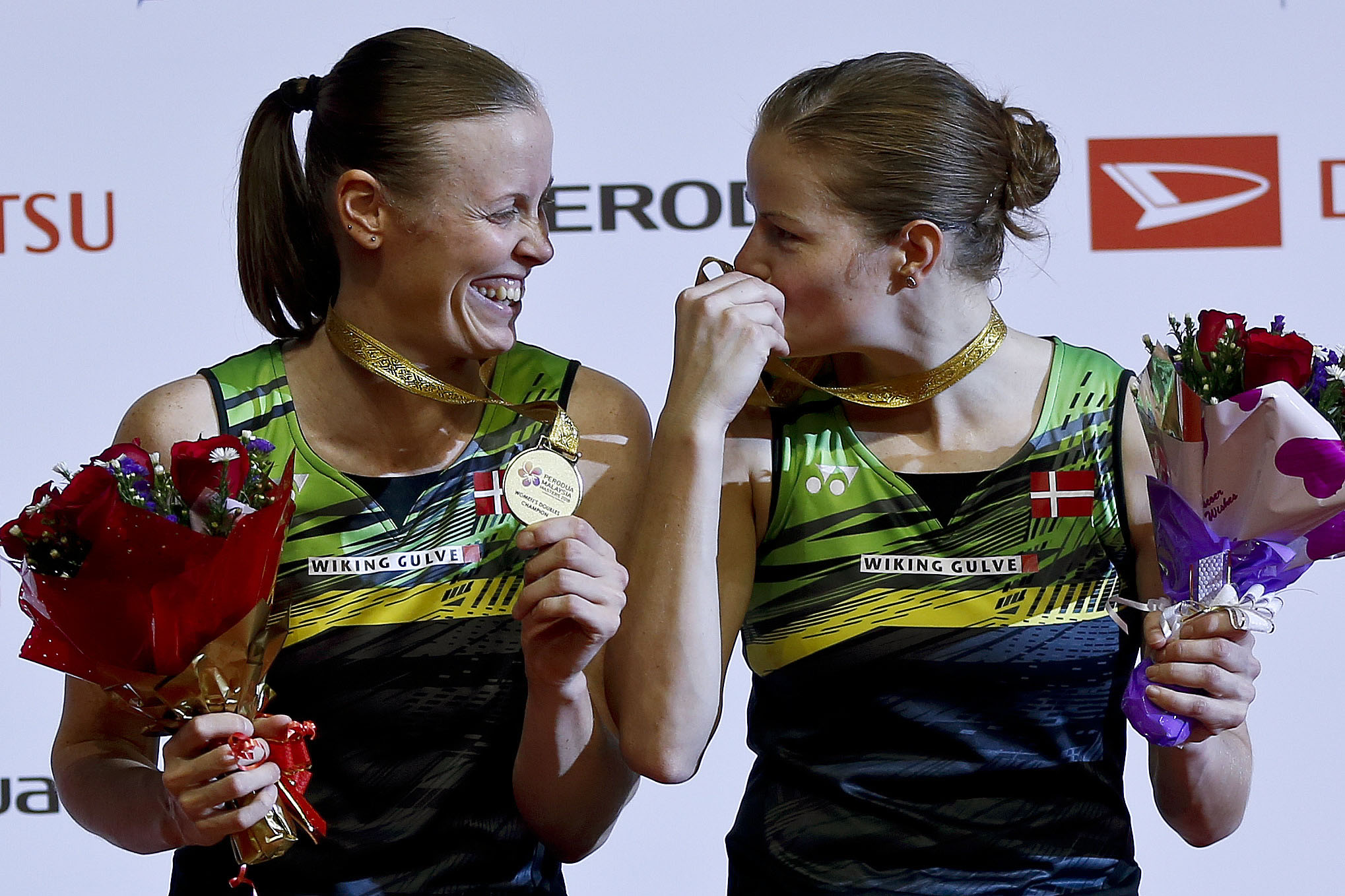 Denmark's Christinna Pedersen (right) and Kamilla Rytter Juhl react at each other with their gold medals during the award ceremony after winning the women's doubles final match against China's Chen Qingchen and Jia Yifan at the Malaysia Masters badminton tournament in Kuala Lumpur, Malaysia on Sunday.