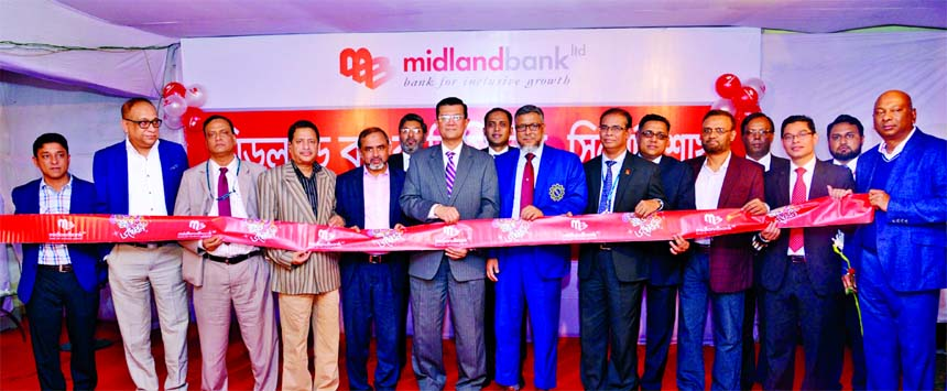 Md. Ahsan-uz Zaman, Managing Director of Midland Bank Limited, inaugurating its Chowhatta Branch at Sylhet Sadar on Thursday. Khandaker Shipar Ahmed, President, Sylhet Chamber and Commerce and Industries, Salauddin Ali Ahmed, Director, FBCCI, Md. Sazzad Hossain, GM, Bangladesh Bank Sylhet Office, other businessmen and local elites were also present.