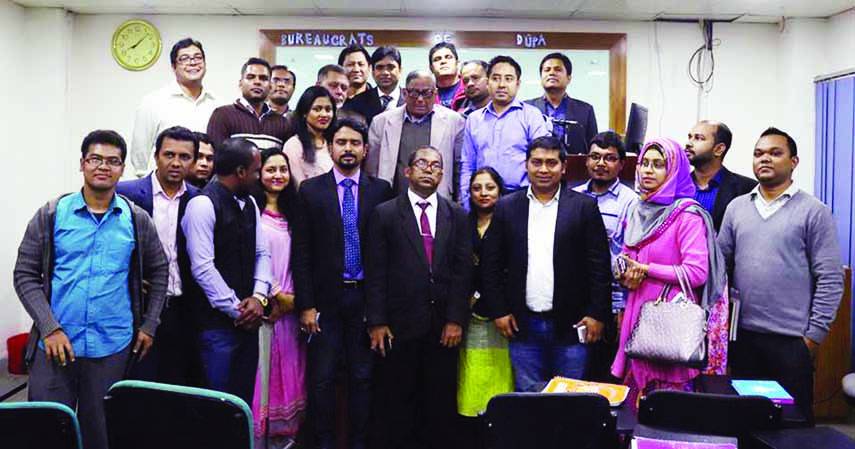 Teachers and students of Public Administration Department of Dhaka University pose for photograph with Adviser of former Caretaker Government Dr Akbar Ali Khan after a discussion titled