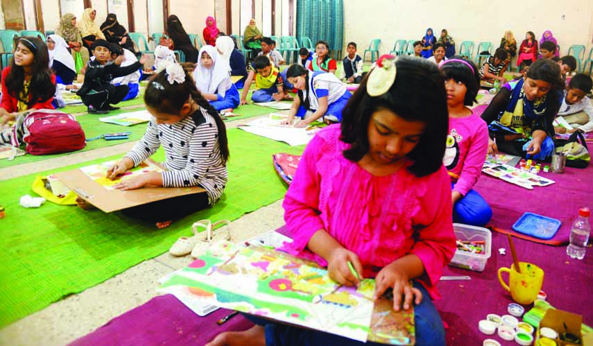 Children engrossed in painting at a drawing competition organised on the occasion of 82nd birth anniversary of Shaheed President Ziaur Rahman by 'Zia Shishu Kishore Sangathan' at the Jatiya Press Club on Monday.