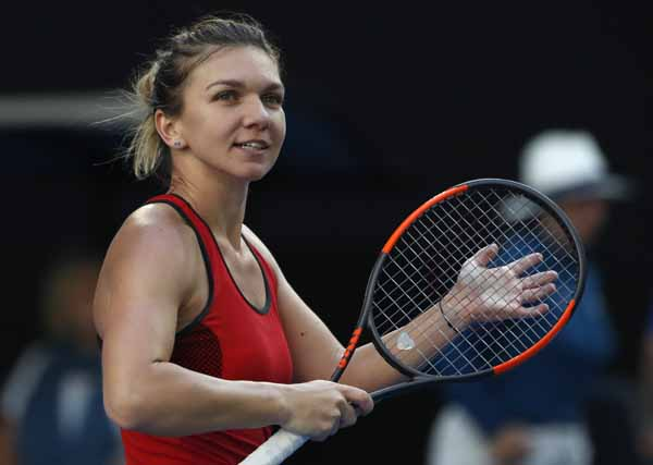 Romania's Simona Halep celebrates after defeating Japan's Naomi Osaka during their fourth round match at the Australian Open tennis championships in Melbourne, Australia on Monday.