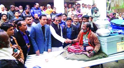 LALMONIRHAT: State Minister for Social Welfare Nuruzzaman Ahmed distributing relief goods among the flood -hit people at a function at Aditmari Upazila  Parishad Hall Room as Chief Guest on Sunday.