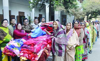 DINAJPUR: Prof Anjuman Akhter, Principal of Dinajpur Government Mahila College distributing blankets among the poor people at the college premises on Sunday.