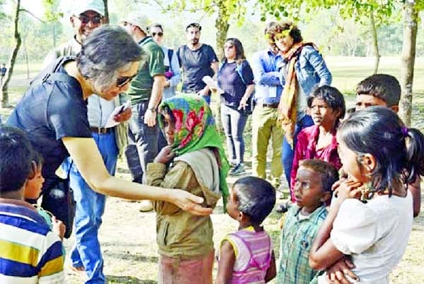 Special envoy of UN Human Rights Commission Young Hy Lee talking to Rohingya children during her visit at Ukhiya camp on Sunday.