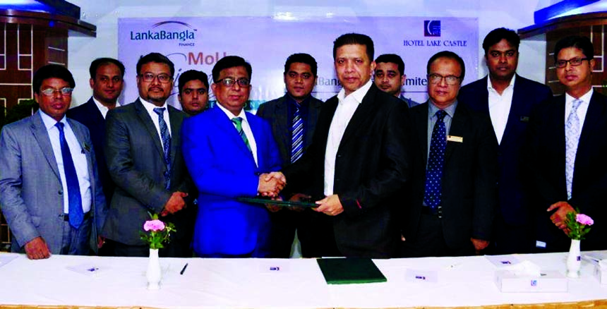 Khurshed Alam, Head of Retail Finance of LankaBangla Finance Limited (LBFL) and Shameem Hasnain Huda, Executive Director of Hotel Lake Castle, exchanging an MoU signing documents at the hotel in the city recently. Under the deal, LBF Card member will enjoy discount facility up to 55 percent at the hotel. Senior officials from both the organizations were also present.