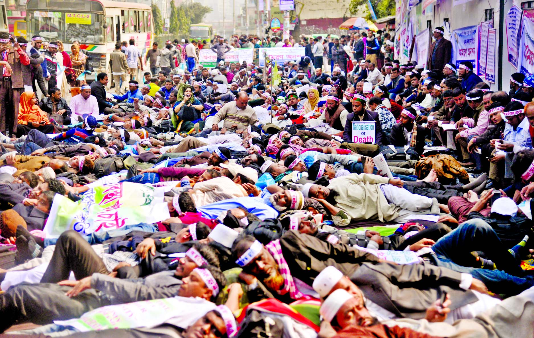 Teachers and employees of non-government schools observing hunger strike for the 9th consecutive day demanding nationalisation of their institutions. This picture was taken from in front of the Jatiya Press Club on Tuesday.