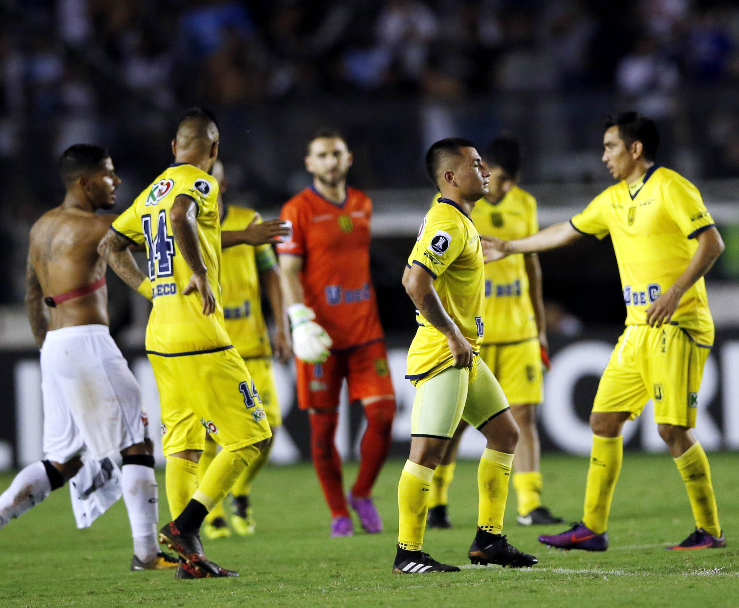 Chile's Universidad Concepcion players leave the field after losing to Brazil's Vasco da Gama during a Copa Libertadores soccer match in Rio de Janeiro, Brazil on Wednesday. Vasco da Gama won 2-0.