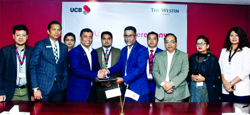 Taufiq Hassan, Executive Vice-President of United Commercial Bank Limited and Shakawath Hossain, Resident Manager of The Westin Dhaka, exchanging a MoU signing documents at the banks head office in the city recently. Senior officials from both the organizations were present.