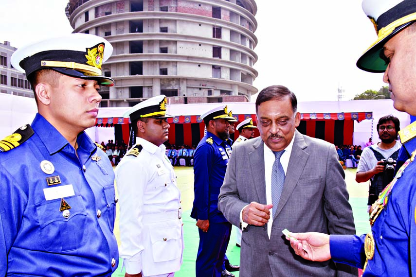Home Minister Asaduzzaman Khan distributing Bangladesh Coastguard Medals among the officials and employees of Bangladesh Coastguard at a ceremony organised recently at its Headquarters in the city 's Agargaon.