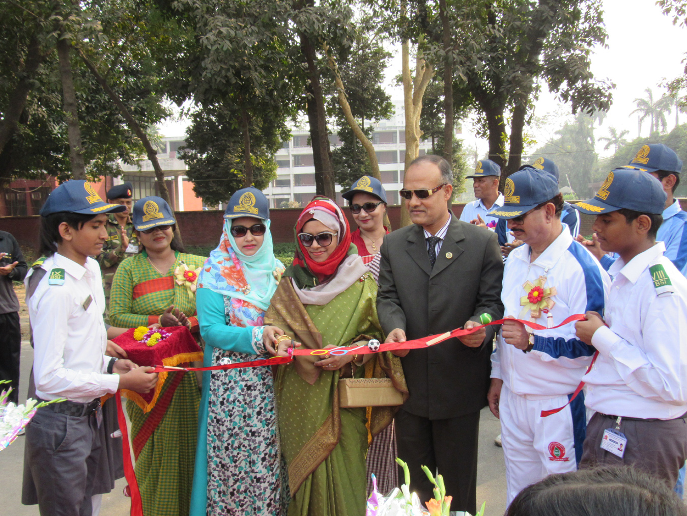 Brigadier General Khondoker Md Mozammel Haque, Commandant COD,  Dhaka Cantonment and  Chairman of  the Governing Body of  BSI and his better half Mst. Rowshan Ara Khondoker inaugurating the Inter House Annual Sports Competition- 2018  of  Baridhara Scholars' Institution (BSI) at Military Wing  Training Ground, COD, Dhaka Cantonment on Saturday.