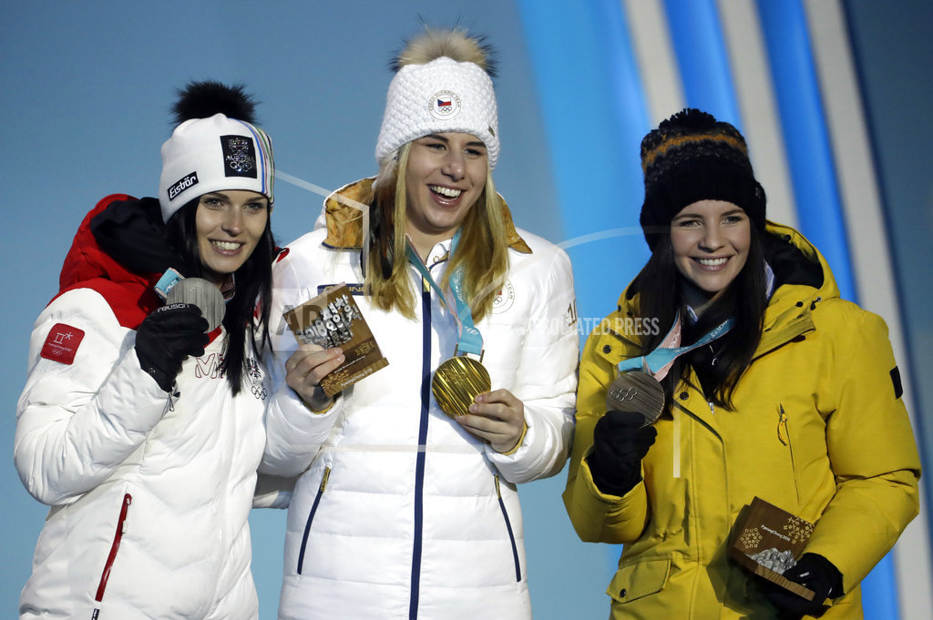 Medalists in the women's super-G from (left) Austria's Anna Veith (silver) Czech Republic's Ester Ledecka (gold) and Liechtenstein's Tina Weirather (bronze) pose during their medals ceremony at the 2018 Winter Olympics in Pyeongchang, South Korea on Saturday.