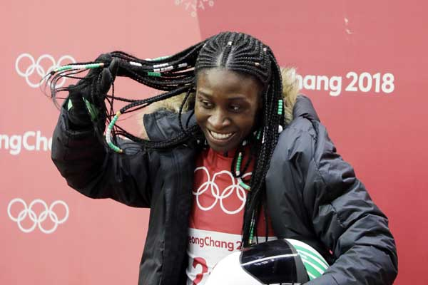 Simidele Adeagbo of Nigeria reacts in the finish area after the final run of the women's skeleton competition at the 2018 Winter Olympics in Pyeongchang, South Korea on Saturday.