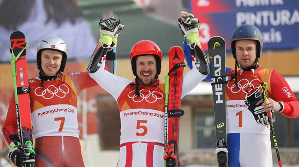 From left : Norway's Henrik Kristoffersen (silver), Austria's Marcel Hirscher (gold) and France's Alexis Pinturault (bronze) celebrate during the flower ceremony for the men's giant slalom at the 2018 Winter Olympics in Pyeongchang, South Korea on Sunday.