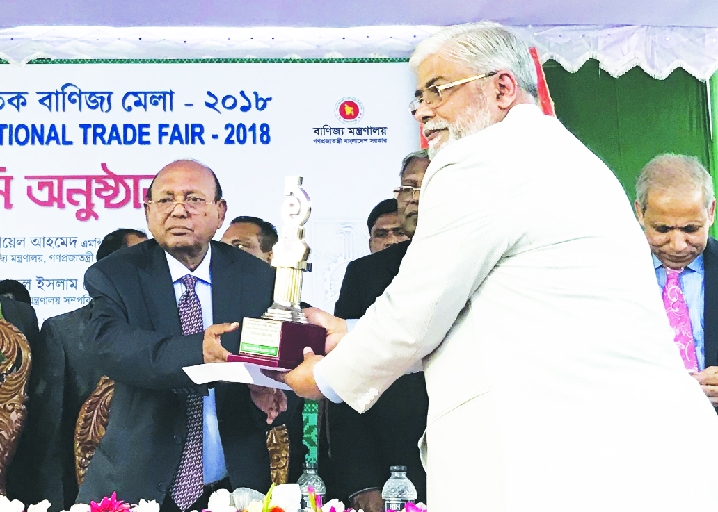 Kazi Rajib Uddin Ahmed Chapol, Chairman of Mousumi Industries Limited, receiving the 2nd prize of DITF-2018 under the General Pavilion Categories at the closing ceremony of Dhaka International Trade Fair in the city recently.