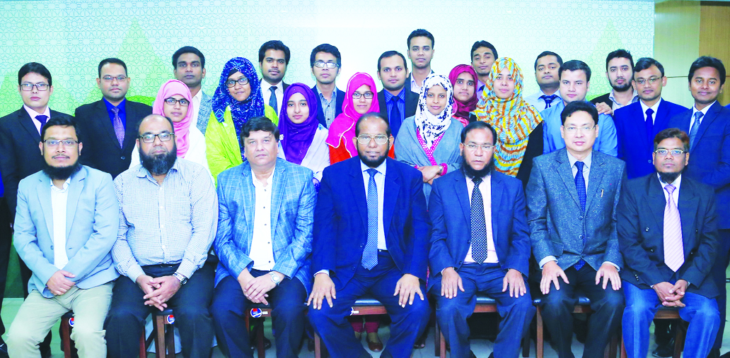Md. Habibur Rahman, Managing Director of Al-Arafah Islami Bank Limited, poses with the participants of a training programme on 'Prevention of Money Laundering and Combating Financing of Terrorism' for its executive officer at its Training and Research Institute' in the city recently. Senior officials of the bank were also present.