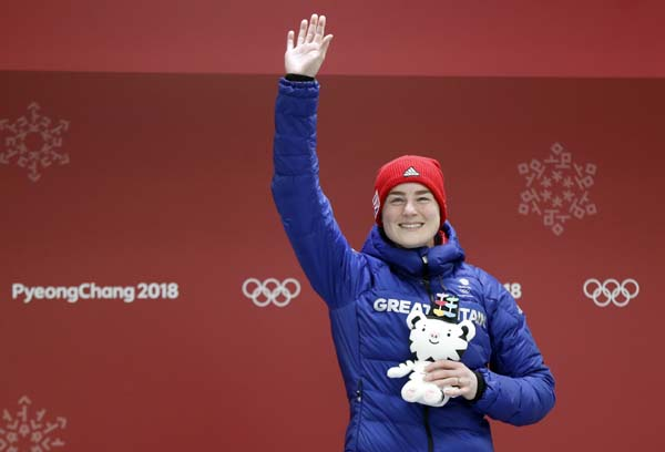 Laura Deas of Britain celebrates winning the bronze medal in the finish area after the final run of the women's skeleton competition at the 2018 Winter Olympics in Pyeongchang, South Korea on Saturday.