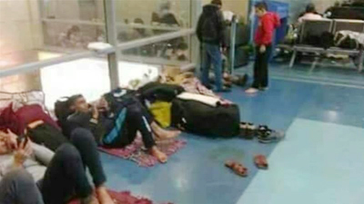 Palestinians stuck in `bad conditions` at Cairo airport