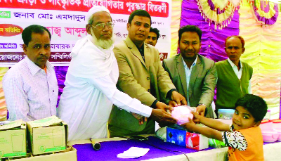 DUPCHANCHIA (Bogra): Mosiul Islam, Assistant Upazla Education Officer  distributing prizes among the winners of  annual sports and cultural function  of Dupchanchia Pre-cadet  School on Sunday.