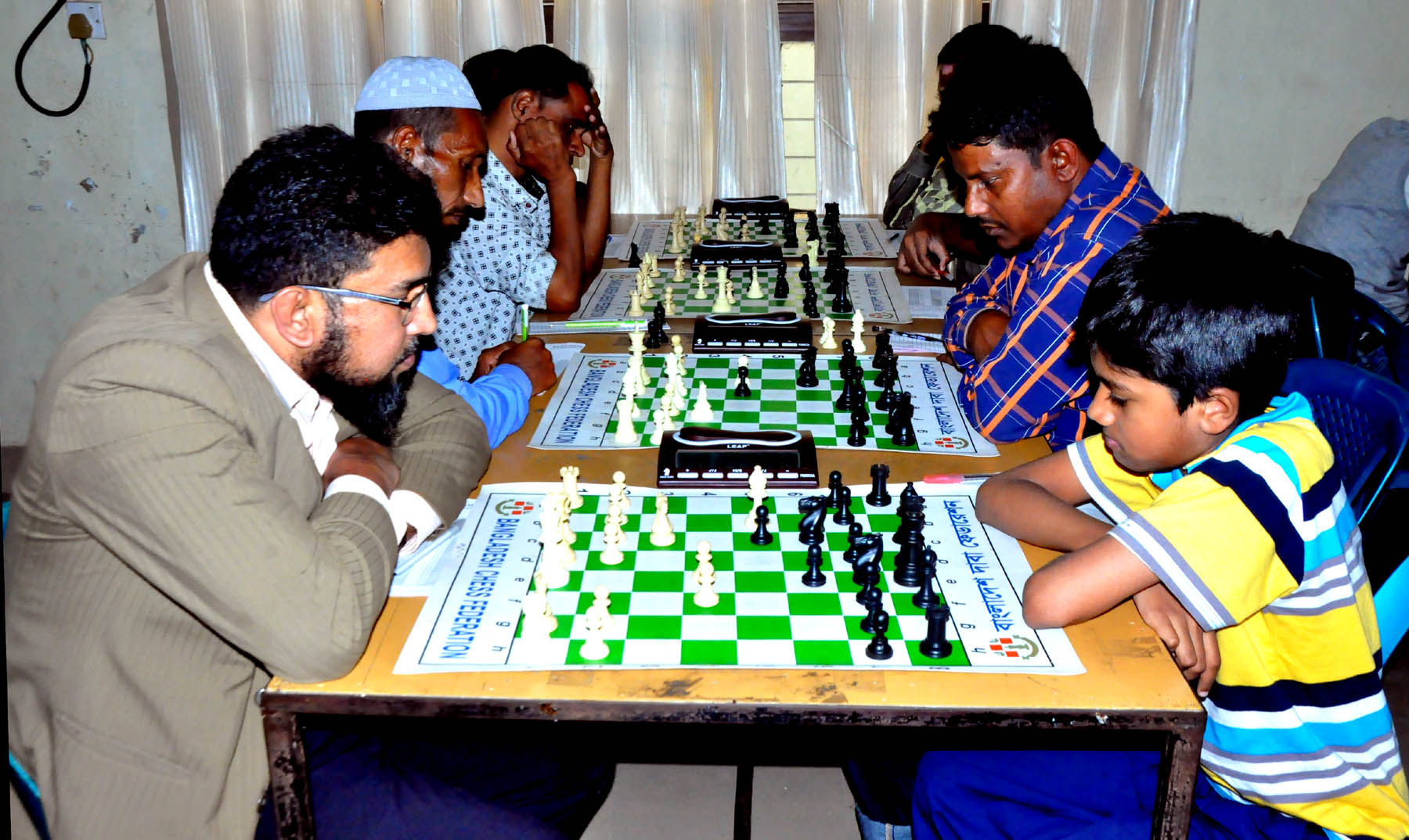 A scene from the 6th round games of Esoft Arena FIDE Rating Chess Tournament below 2000 rating at Bangladesh Chess Federation hall-room at 2nd floor of National Sports Council old building on Monday.