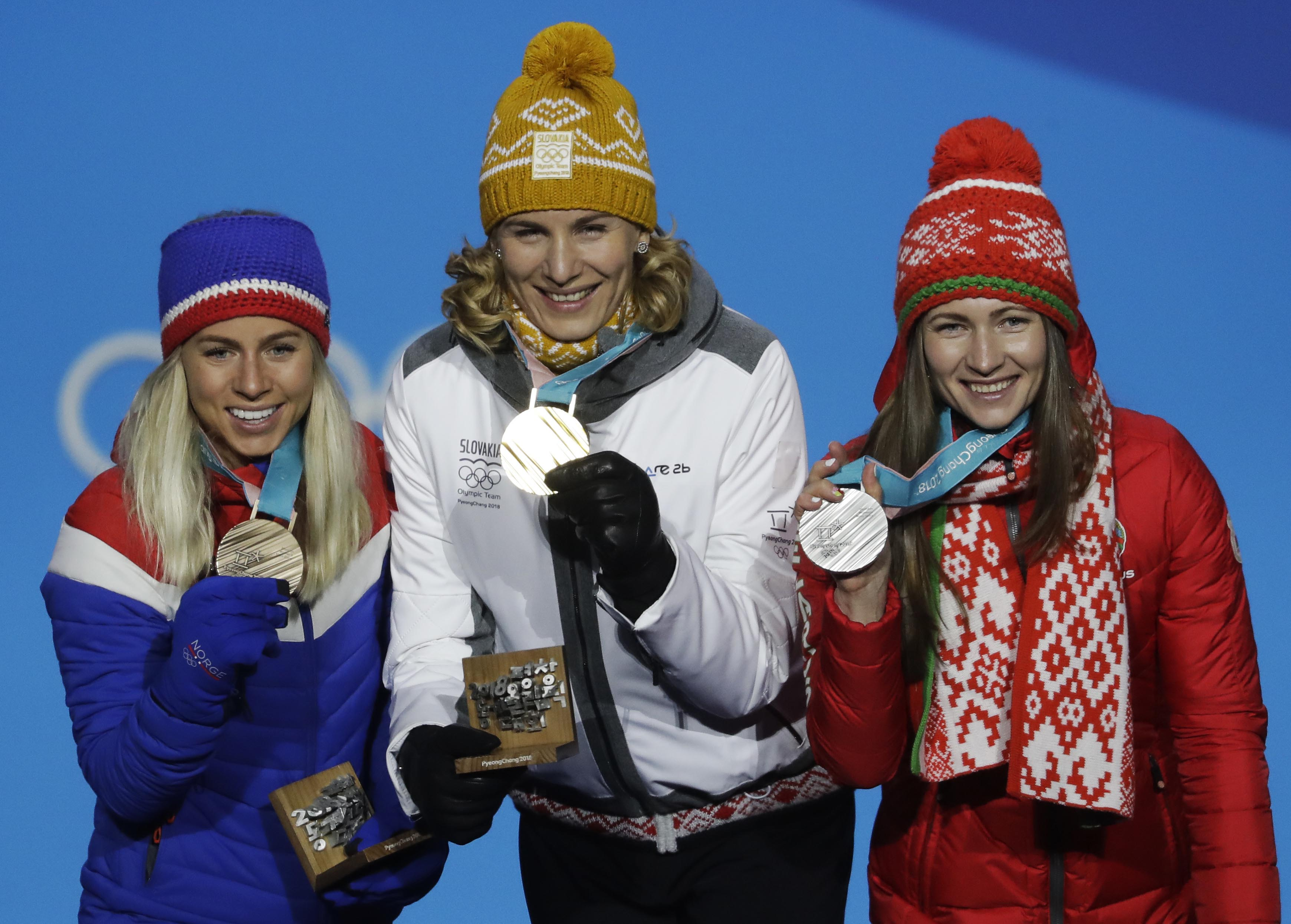 Medalists in the women's 12.5-kilometer mass start biathlon (from right) Belarus' Darya Domracheva (silver), Slovakia's Anastasiya Kuzmina (gold) and Norway's Tiril Eckhoff (bronze) pose during their medals ceremony at the 2018 Winter Olympics in Pyeongchang, South Korea on Sunday.