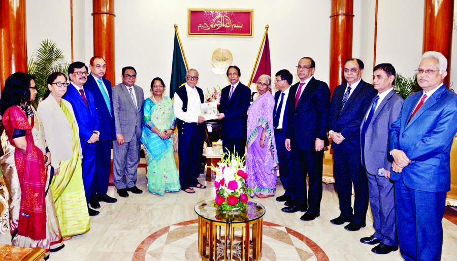 President Abdul Hamid receiving the annual report-2017 of Bangladesh Public Service Commission from its Chairman Dr Mohammad Sadik when the  delegation of the commission called on President to submit the report at Bangabhaban on Tuesday.