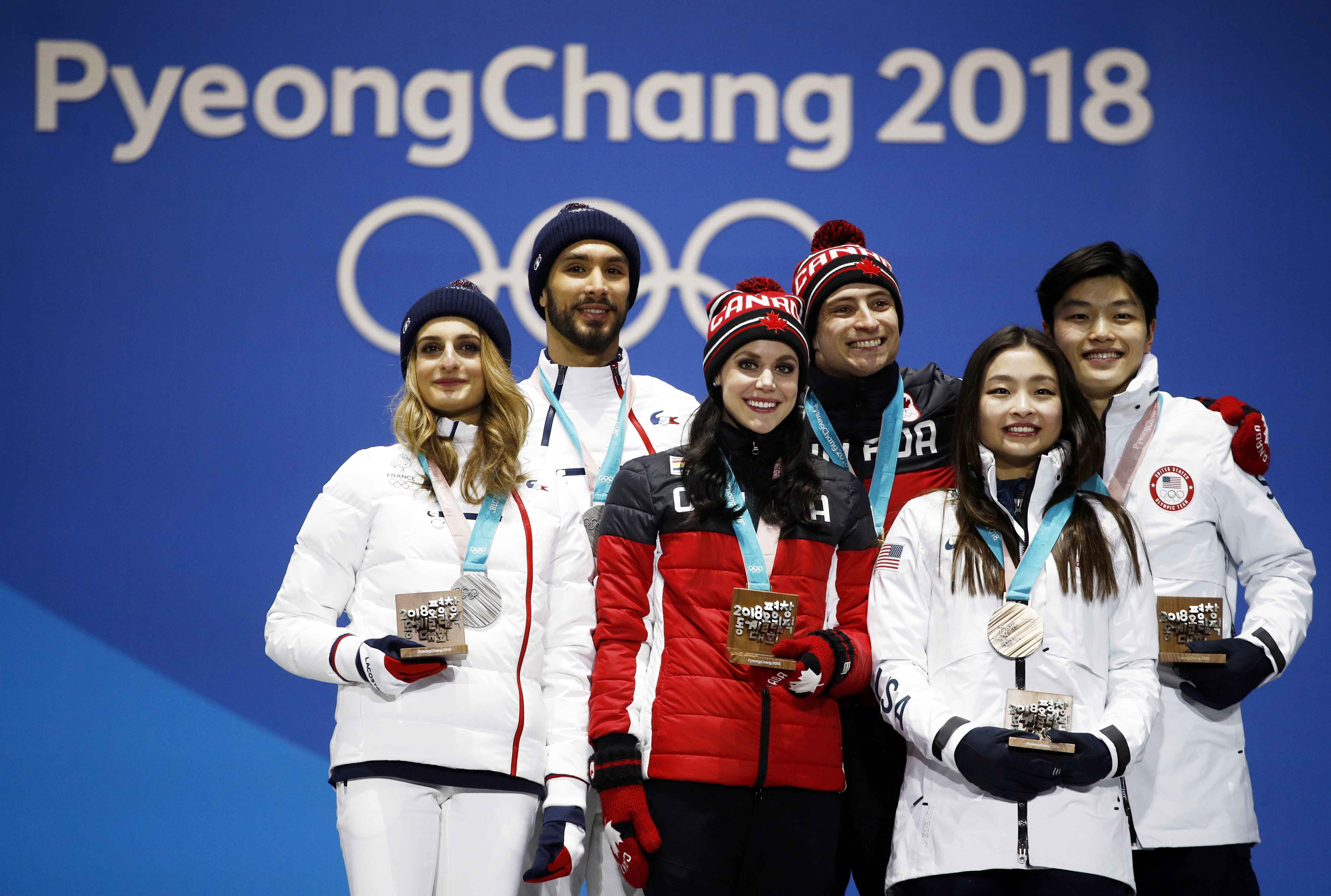 Medalists in the ice dance, free dance figure skating (from left) : Gabriella Papadakis and Guillaume Cizeron, of France (silver), Tessa Virtue and Scott Moir of Canada (gold) and Maia Shibutani and Alex Shibutani of the United States (bronze) pose during their medals ceremony at the 2018 Winter Olympics in Pyeongchang, South Korea on Tuesday.
