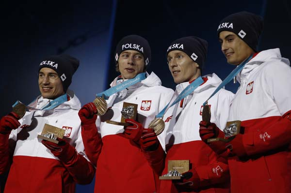 Ski jumping team bronze medalists from Poland smile during their medals ceremony at the 2018 Winter Olympics in Pyeongchang, South Korea on Tuesday.