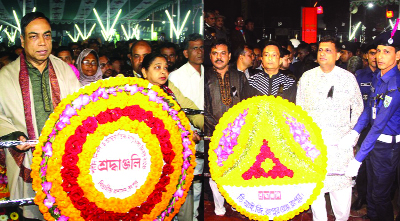 RANGPUR:  Kazi Hasan Mahmud, DC(left) and Khondker Golam Faruk(right),  DIG for Rangpur Range placing wreaths at the Central Shaheed Minar in observance of the Shaheed Dibosh and International Mother Language Day on Wednesday.