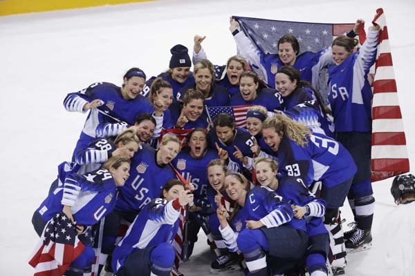 The United States team celebrates winning the women's gold medal hockey game against Canada at the 2018 Winter Olympics in Gangneung, South Korea on Thursday.