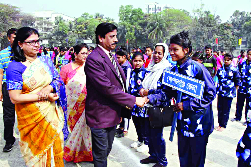 President of Dhaka Divisional Sports Association and Divisional Commissioner of Dhaka Division M Bajlul Karim Chowdhury being introduced with the participants of the Rural Sports Competition at the Sultana Kamal Women's Sports Complex in the city's Dhanmondi on Friday.