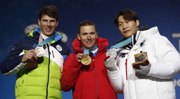 Medalist in the men's parallel giant slalom (from right) South Korea's Lee Sangho (silver), Switzerland's Nevin Galmarini (gold) and Slovenia's Zan Kosir (bronze) pose during their medals ceremony at the 2018 Winter Olympics in Pyeongchang, South Korea on Saturday.