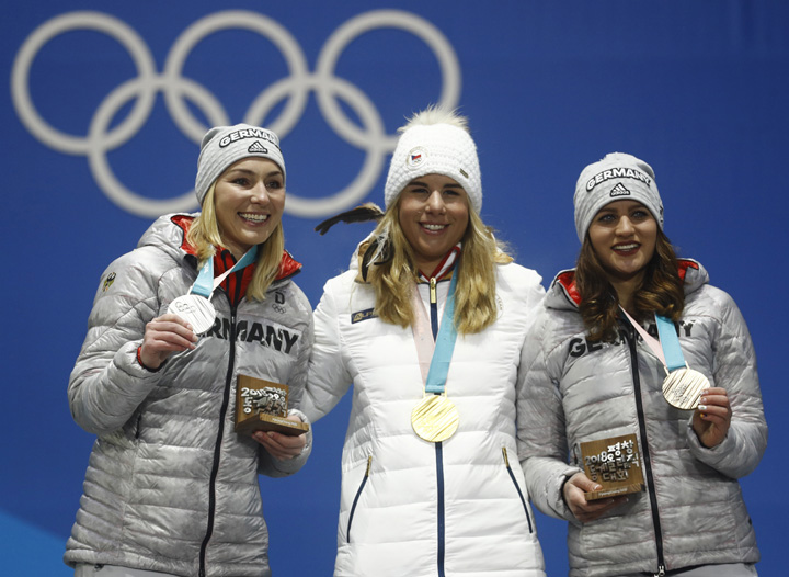 Medalists in the women's parallel giant slalom (from left) Germany's Selina Joerg (silver), the Czech Republic's Ester Ledecka (gold) and Germany's Ramona Theresia Hofmeister (bronze) pose during their medals ceremony at the 2018 Winter Olympics in Pyeongchang, South Korea on Saturday.