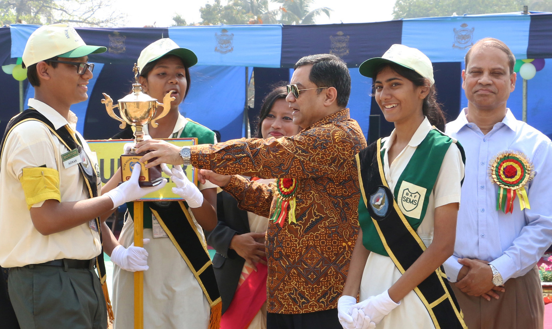 Air Officer Commanding of BAF Base Bashar Air Vice Marshal Ehsanul Gani Choudhury handing over the trophy to the winners of the Annual Sports Competition of the BAF Shaheen English Medium School (SEMS) at the School premises in the city on Saturday.