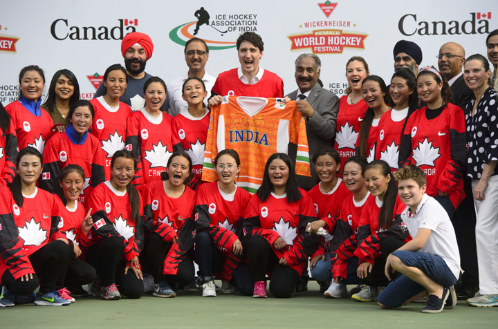 Canadian Prime Minister Justin Trudeau takes part in a hockey event with Hayley Wickenheiser (not pictured) and the Indian women's national ice hockey team at the Canadian High Commission of Canada in New Delhi, India on Saturday.