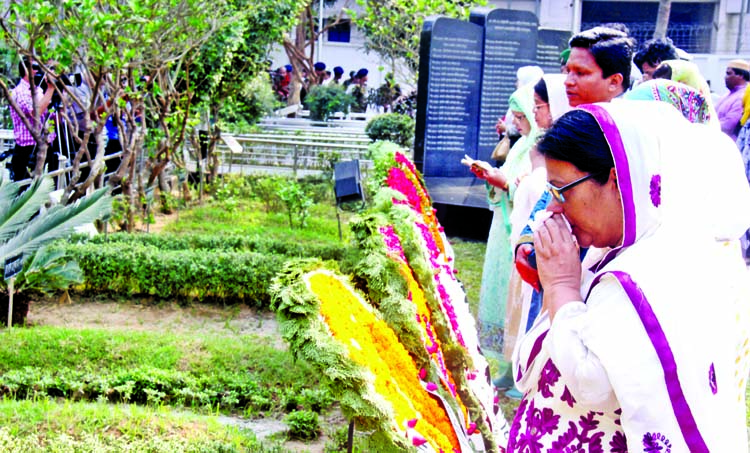 Relatives of killed army officials in Pilkhana BDR carnage placing floral wreaths at their graves in Banani Army Graveyard in the city on Sunday marking ninth anniversary of BDR carnage.
