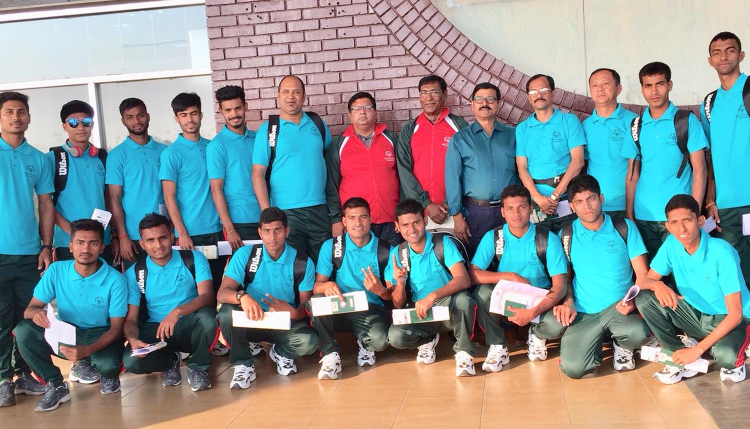 Members of Bangladesh Special Olympics Football team pose for a photo session at the Hazrat Shahjalal International Airport on Monday before leaving for Abu Dhabi to take part in the Special Olympics Football Competition scheduled to be held from March 14 to March 22.