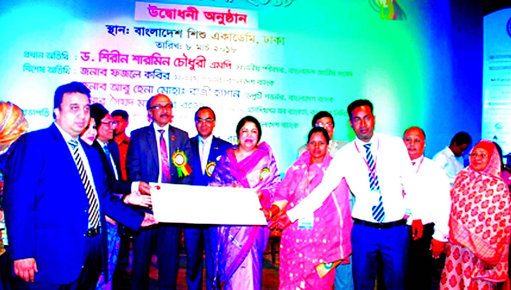 Speaker of the Parliament Dr. Shirin Sharmin Chaudhury MP and Bangladesh Bank Governor Fazle Kabir handing  over a cheque of Tk 25 lakh financed by ONE Bank Limited (OBL) to an women entrepreneur at the Banker-SME Women Entrepreneur Conference and Product Display Fair-2018 at Banglades Sishu Academy in the city recently. Sadat Ahmed Khan, Head of SME of OBL and senior officials from different organizations were also present.