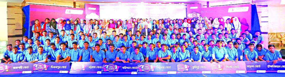 Alamgir Kabir, Chairman of Southeast Bank Limited, poses with the 200 scholarship winner students at a city club recently organized by Southeast Bank Foundation. M Kamal Hossain, Managing Director and Directors of the bank were also present.