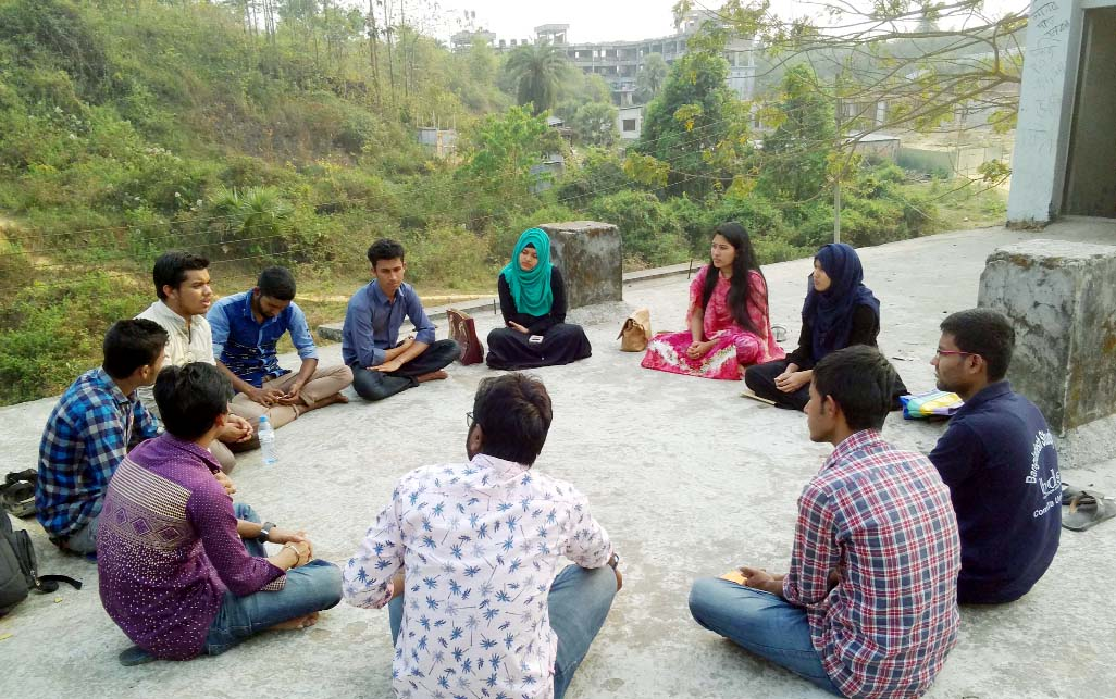 Members of the Anushwar in a lecture session are seen discussing about literature.