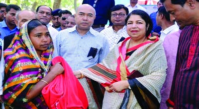 RANGPUR: Speaker of the Jatiya Sangsad Dr. Shirin Sharmin Chaudhury distributing blankets among poor and distressed women at a function held on the 'Dak Bungalow' premises in Pirganj town as Chief Guest on Thursday .