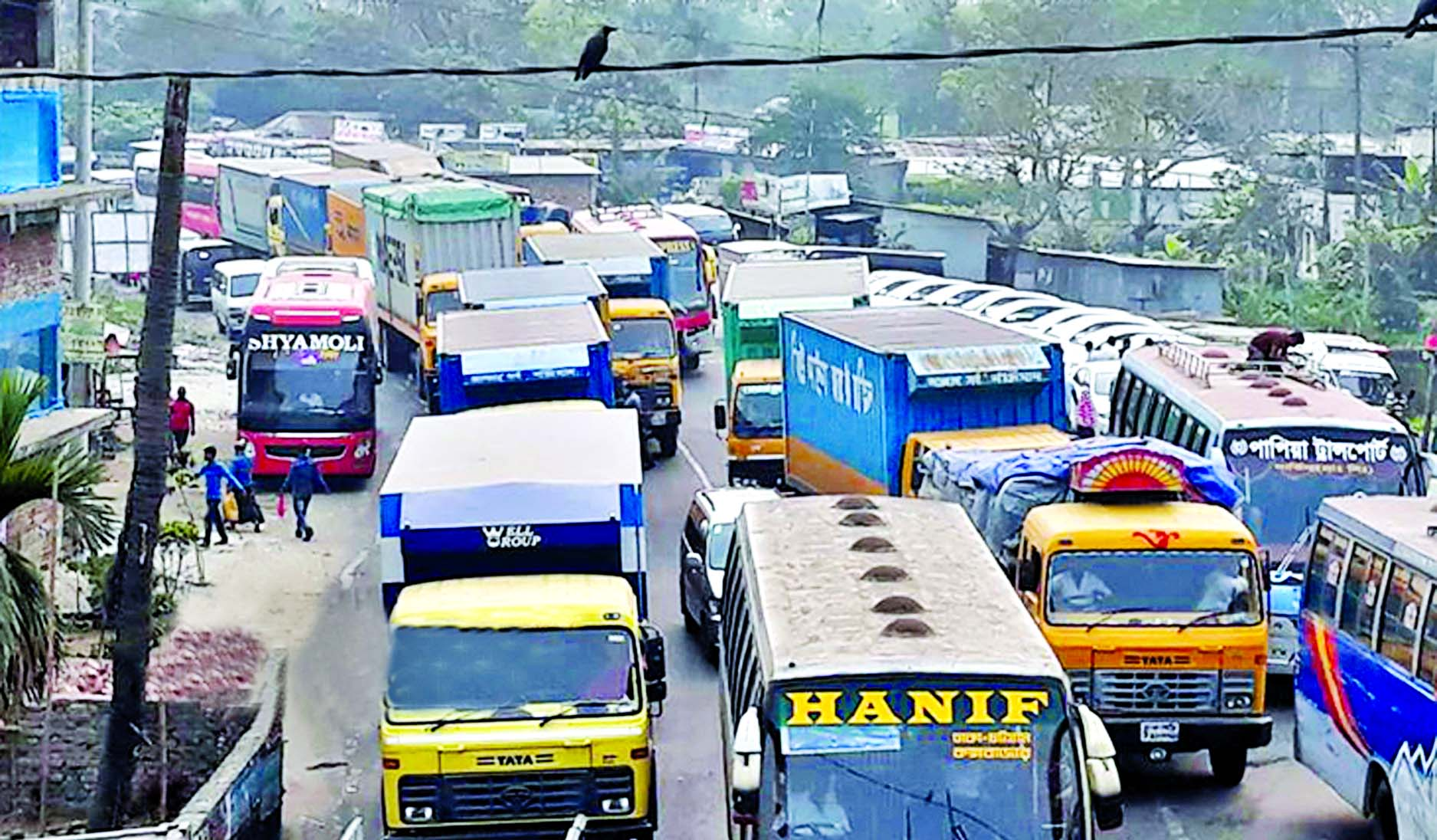 Hundreds of vehicles got stuck in 15 km long tailback due to continuous eight-lane work of Dhaka-Comilla Highway. This photo was taken from Daudkandi-Gouripur area on Friday.