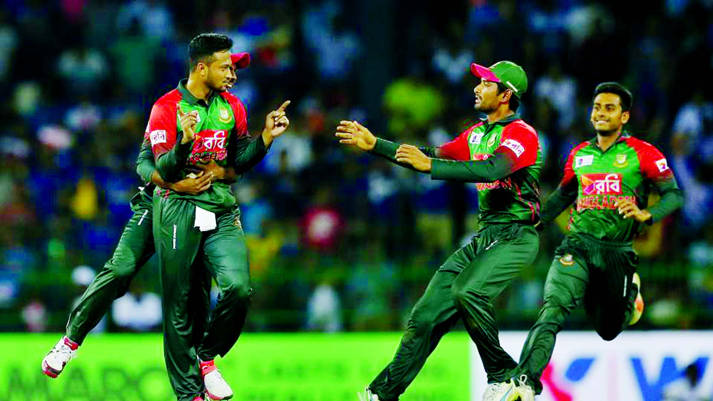 Shakib Al Hasan (left) celebrates the dismissal of Danushka Gunathilaka during their second Twenty20 cricket match in Nidahas Trophy in Colombo on Friday.
