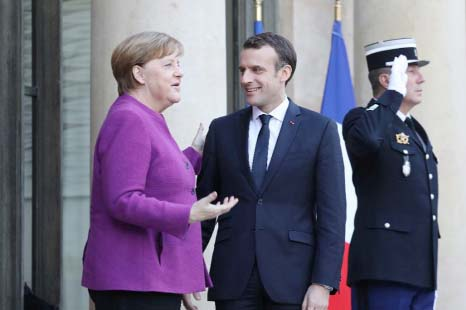 Macron, Merkel promise EU reform roadmap by June