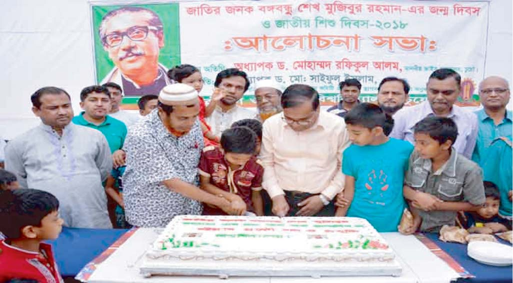 Prof Dr Rafiqul Alam, VC, Chittagong University of Engineering & Technology cutting cake on the occasion of 98th birth anniversary of Bangabandhu Sheikh Mujibur Rahman at CUET campus yesterday.